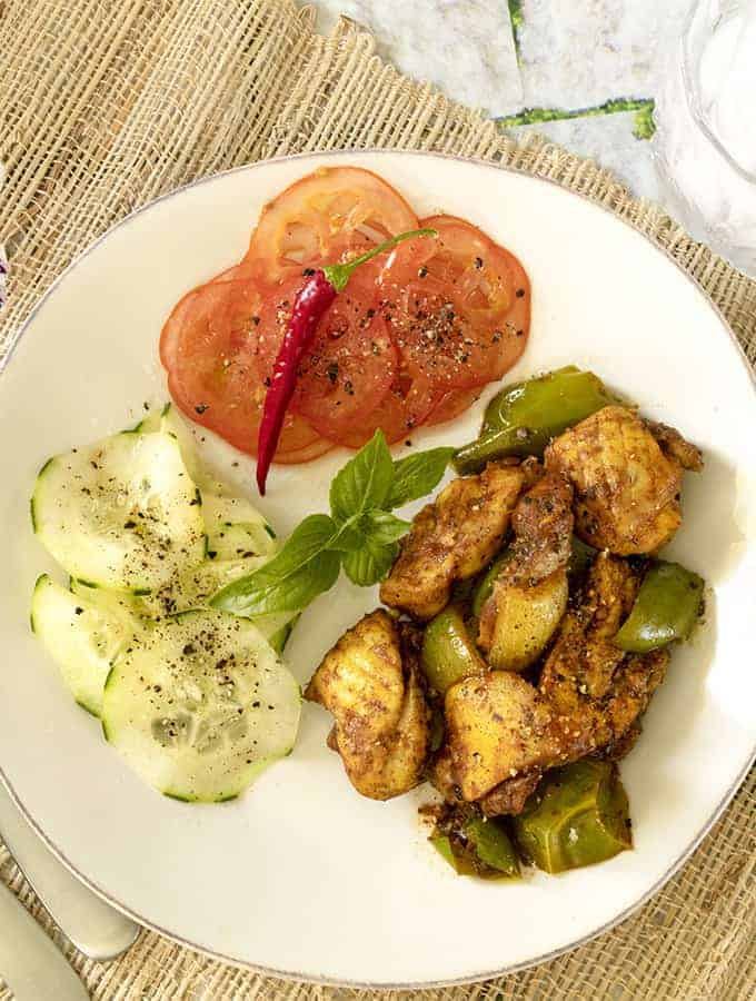 Chicken Jalfrezi overhead shot with cucumbers and tomato