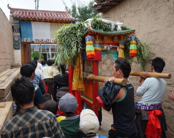 Processing the god through the streets of Nyantok Village, Rebgong, Gansu