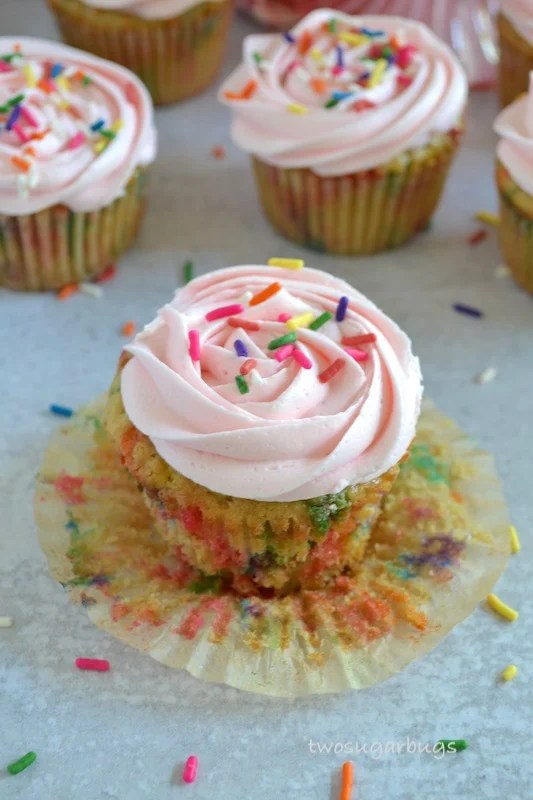 Easy one bowl funfetti cupcake with liner peeled back