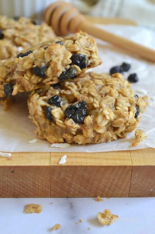 Two breakfast cookies on a cutting board