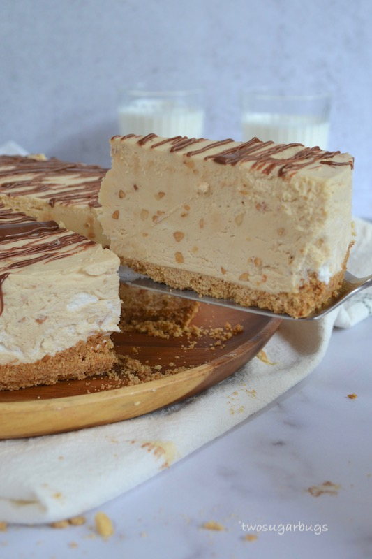 Slice of peanut butter pie being lifted from serving plate