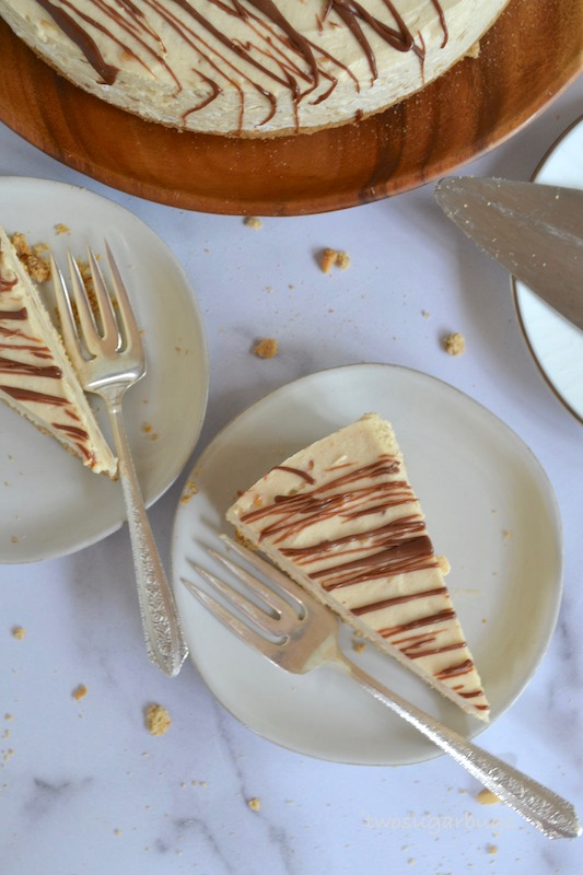 Two pieces of peanut butter pie on plates with forks