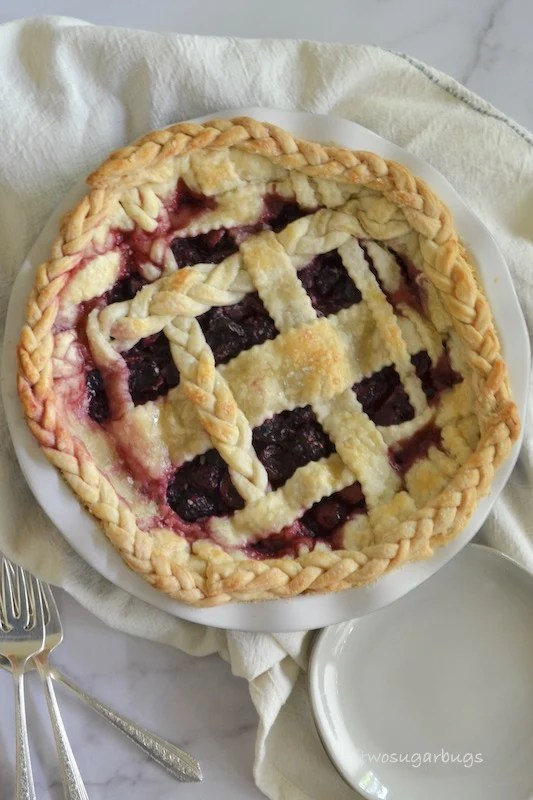 Blackberry and cherry pie; two of summer's gorgeous fruits combine the best of sweet and slightly tart all wrapped up in a flakey all-butter pie crust.  This easy blackberry cherry pie recipe is the ultimate summer pie! #twosugarbugs #blackberrycherrypie #summerpie #fruitpie #allbuttercrust