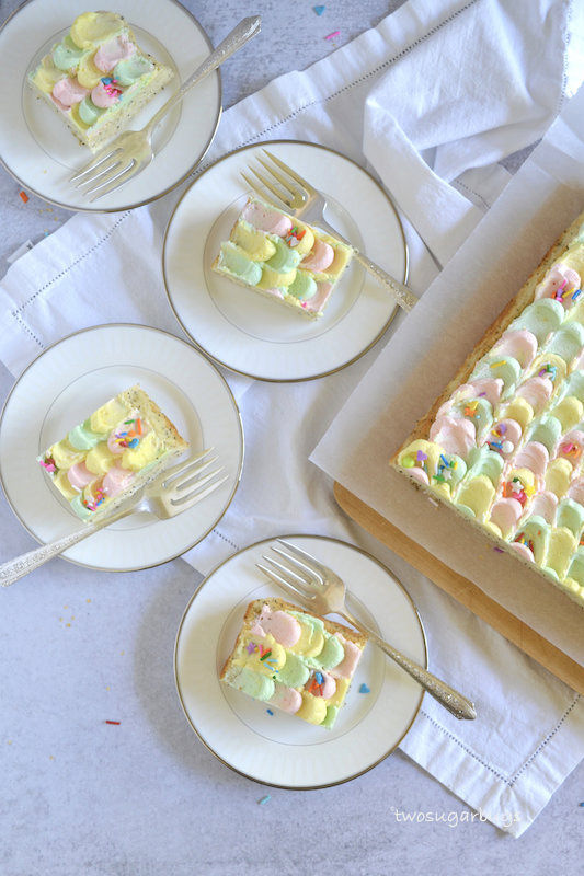 four plates with cake slices and a fork