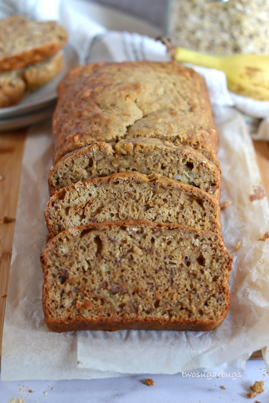 Sliced banana bread on parchment paper