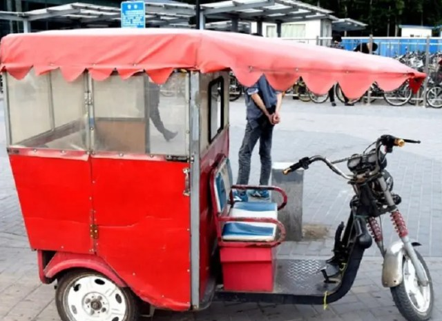 A typical Chinese tuk tuk - your carriage awaits!