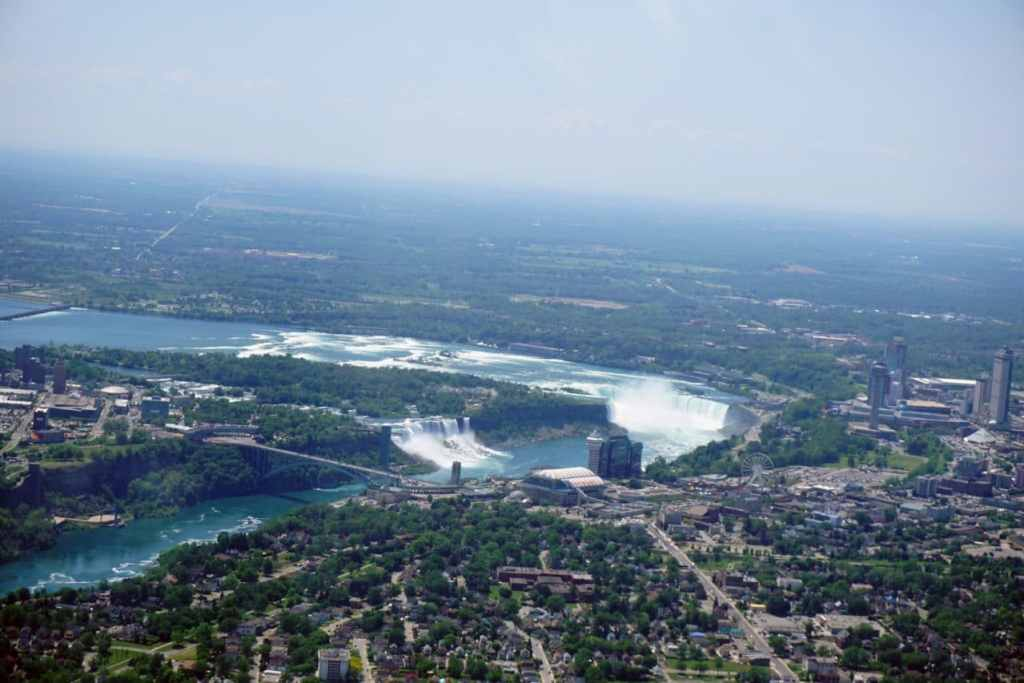 "Here you can see the Rainbow Bridge, the American Falls, the Bridal Falls, and the Horseshoe Falls. - ""Niagara Falls Helicopter Ride to Remember"" - Two Traveling Texans"