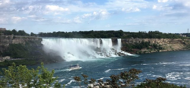 """The American Falls and the Bridal Veil Falls are right next to each other. The Bridal Veil Falls is on the right. - """"Cave of the Winds Niagara Falls Closeup"""" - Two Traveling Texans"""