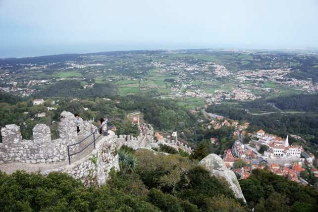 "Looking down from the Moorish Castle, you can see the National Palace of Sintra. -""Plan Your Own Sintra Tour"""