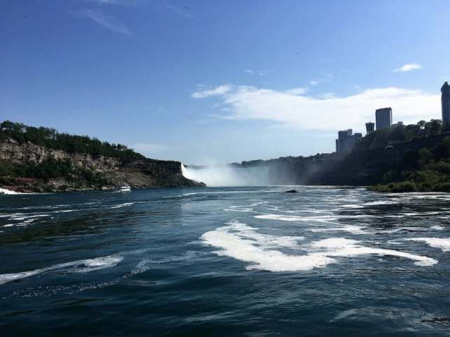"""You can see the river looks pretty calm heading towards the Horseshoe Falls. - """"Hornblower Niagara Cruises Vs Maid of the Mist"""" - Two Traveling Texans"""