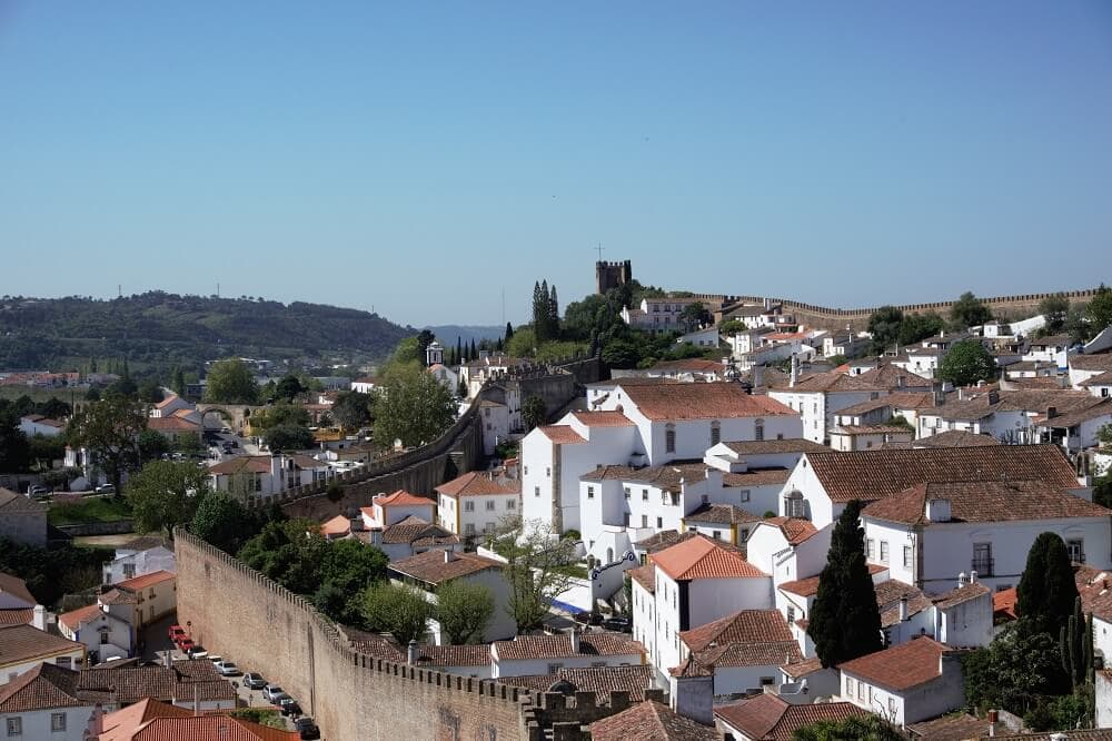 """A view over Obidos from the city wall walk. - """"Our Amazing Portugal Road Trip Itinerary"""" - Two Traveling Texans"""