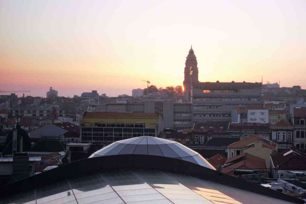 """Sunset over Porto- """"Our Amazing Portugal Road Trip Itinerary"""" - Two Traveling Texans"""