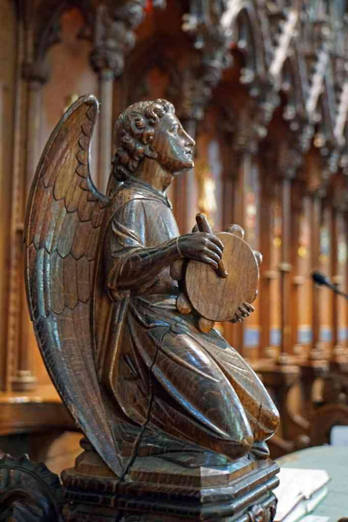 Carved wooden Angel in the Salisbury Cathedral Quire - Two Traveling Texans