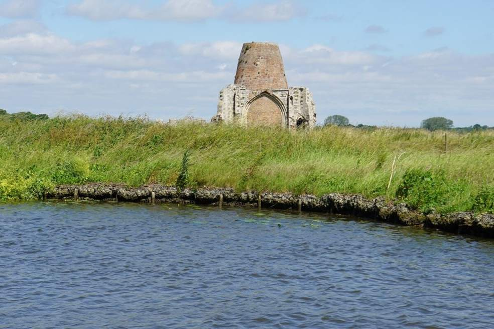 """View of St. Benets Abbey from the Broads. - """" Hire a Boat on the Norfolk Broads"""" - Two Traveling Texans"""