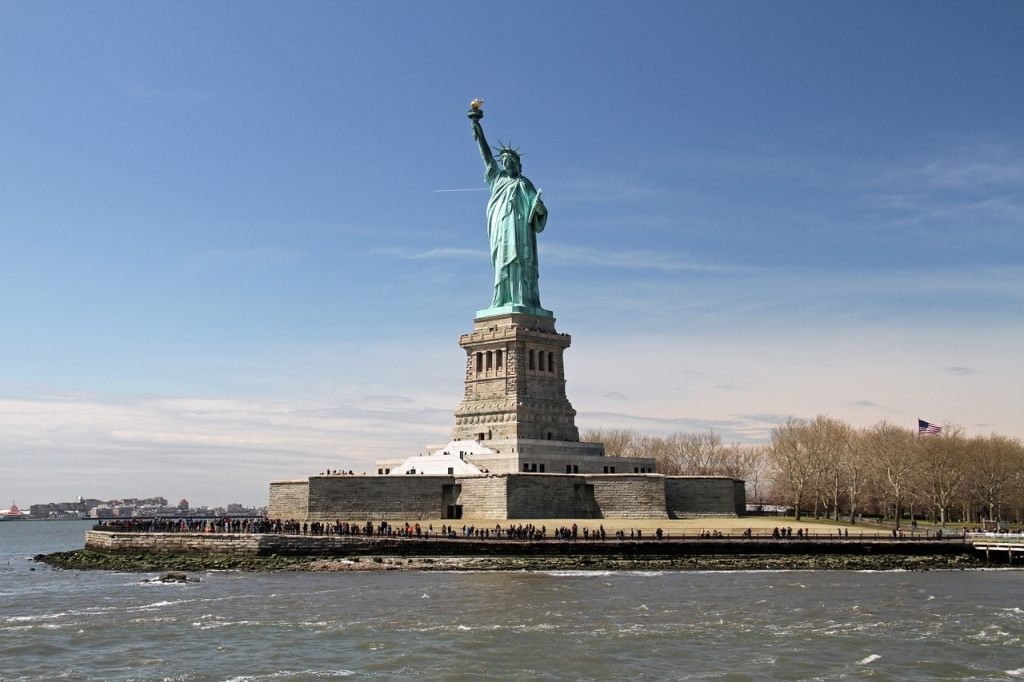 """The Statue of Liberty stands proud in the New York Harbor. - - """"Tips for Visiting New York City For the First Time"""" - Two Traveling Texans"""