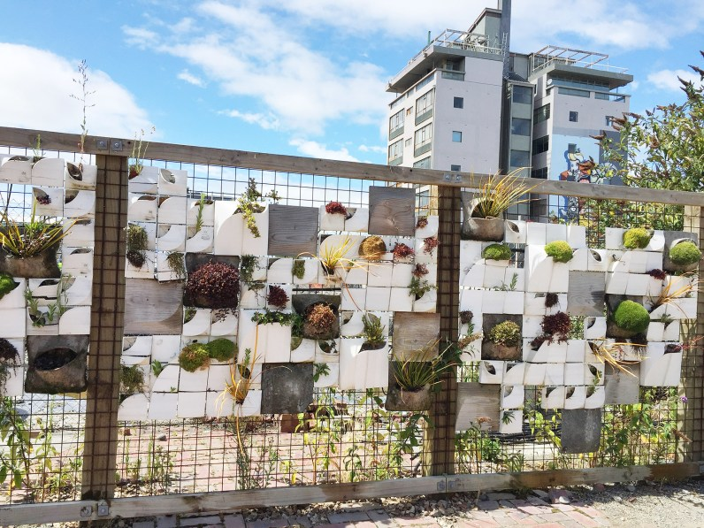 Guerilla Gardening on a fence of a work site