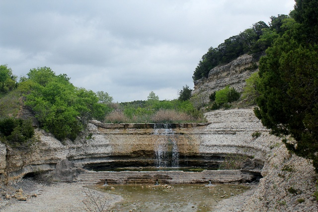 Looking at three-tiered spillway on our hiking at Cleburne State Park, Texas.