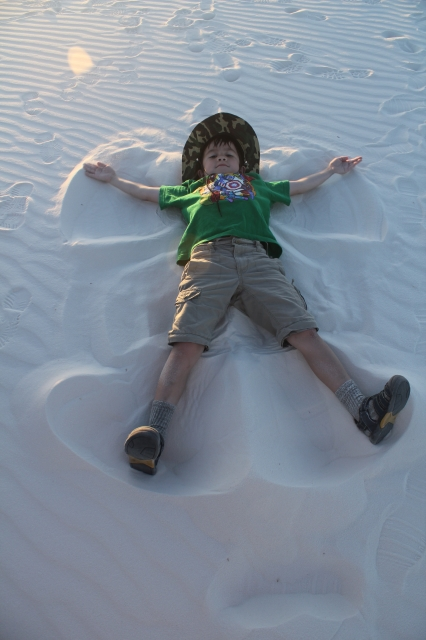 Making snow angel at White Sands National Monument