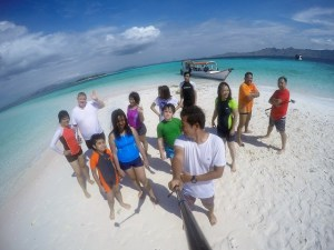 Two Worlds Treasures - group picture at White Sandy Beach, Labuan Bajo, Flores, Indonesia.