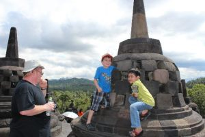 Borobudur temple - touching Buddha's head - Two Worlds Treasures