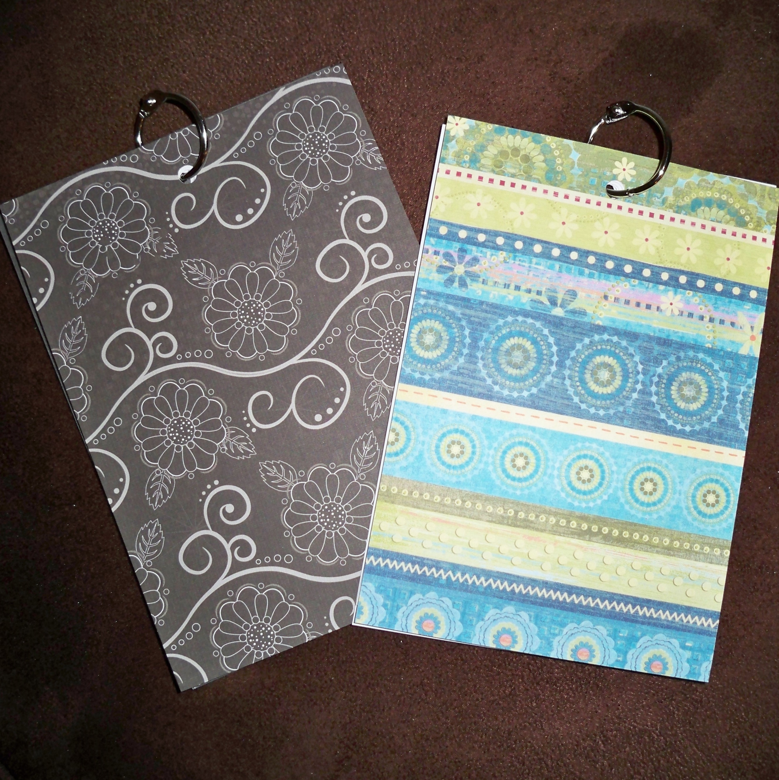 "Each journal was made with a 1"" book ring from Staples and some card stock I had at home."
