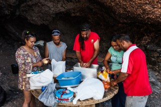 Preparing Plo, a rice curry dish involved many hands to make light work.