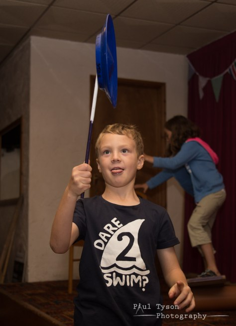 Oliver practicing his plate spinning at Circus skills class. With the Tyson tongue!