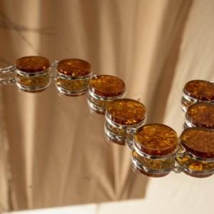 дизайнерские браслеты из серебра с янтарем