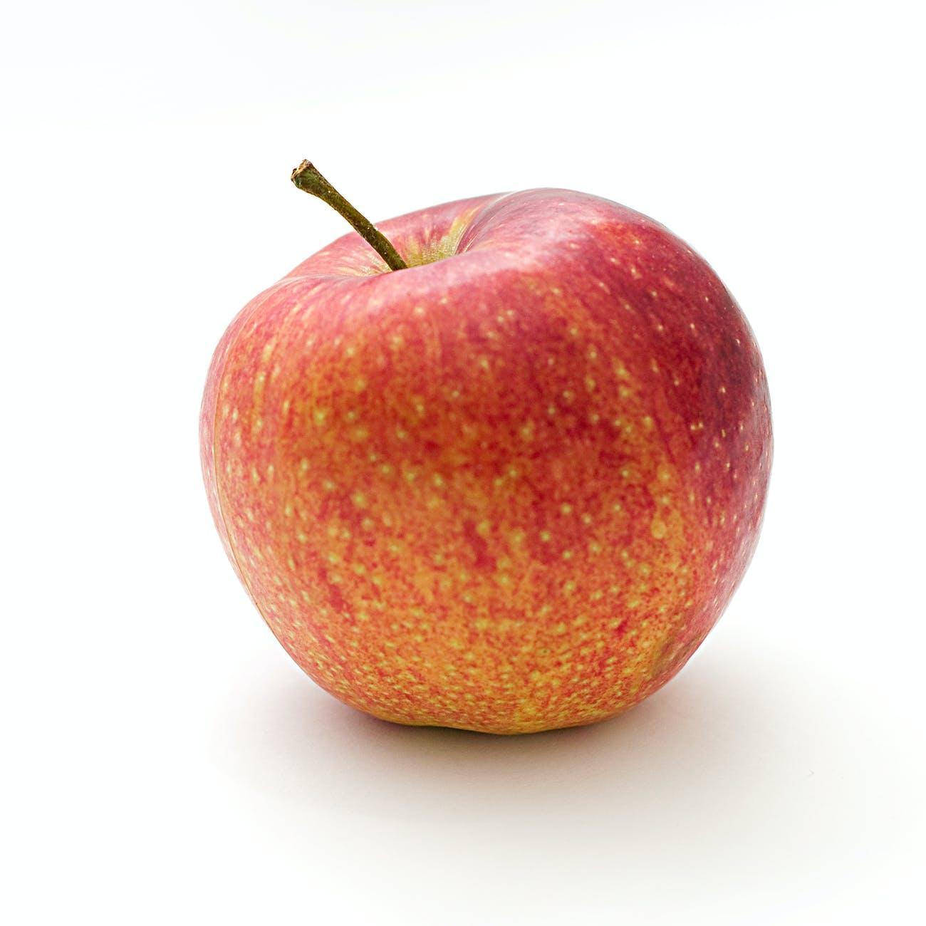 red and orange apple fruit