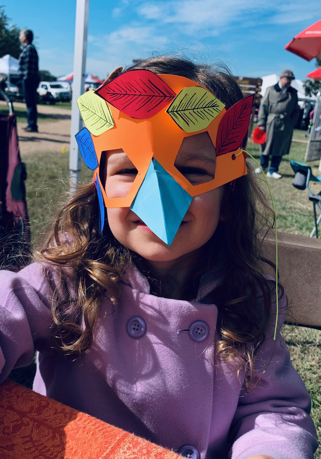 A visitor shown in another cute bird mask!