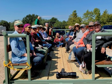 Group photo of Fall 2019 Training Class sitting on trailer at Long Point Ranch