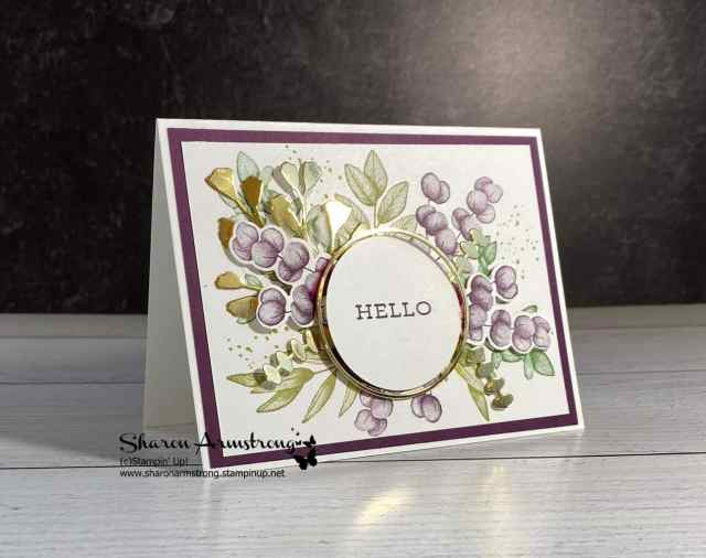 This gorgeous card features die cutting magic with purple flowers, green leaves and layered around a circle