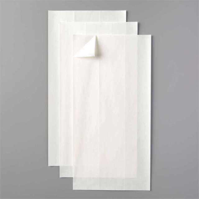 Cling adhesive sheets are perfect for using on intricate die cut words and letters.