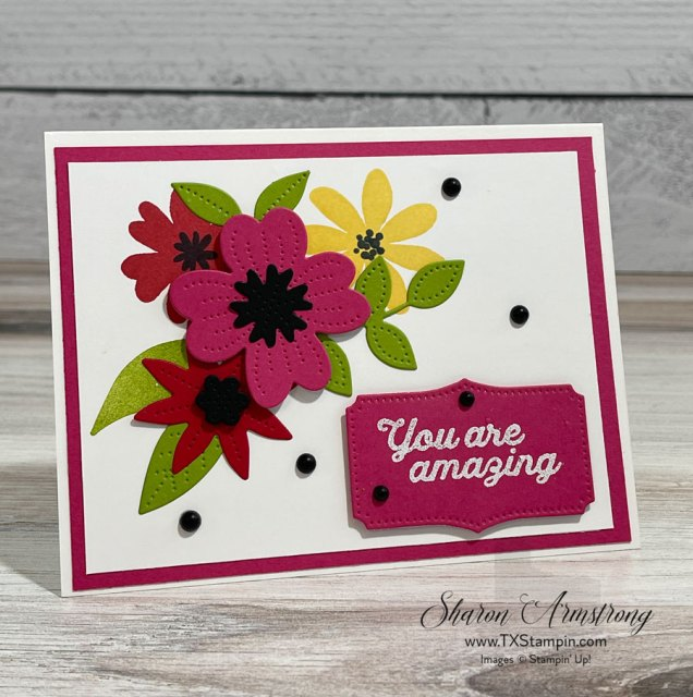 Make a spring card with cute floral die cuts and embossed greetings.