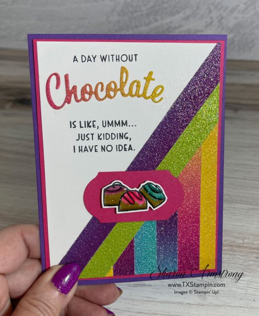The best handmade cards for chocolate lovers is complete with rainbow glimmer paper and crystal effects on top of the candy.