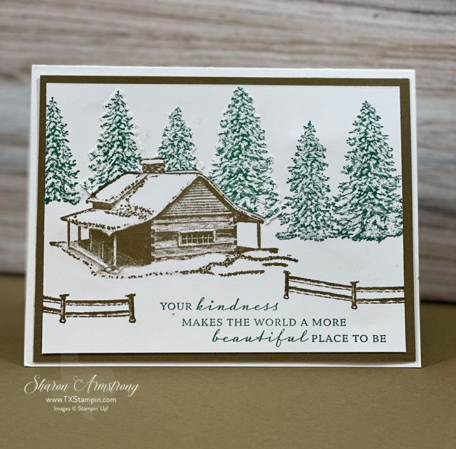 this-christmas-card-has-snow-covered-cabin-roof-and-trees