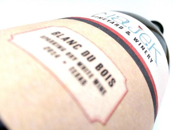 Majek Vineyard Blanc du Bois - blurred bottle