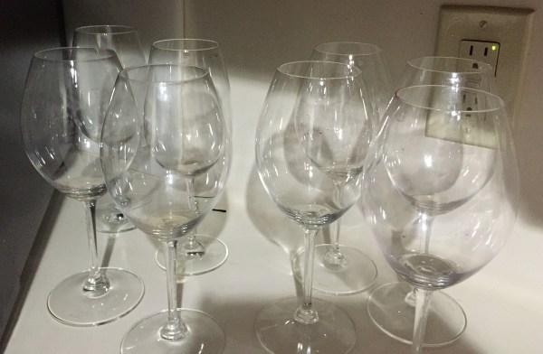 Wine glasses needing cleaning