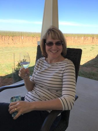 Laurie Ware enjoying a white wine (huh?) on the Day's side porch