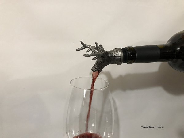 Buck wine pourer in action