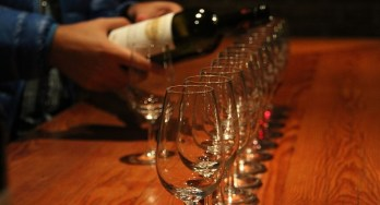 wine pouring into multiple glasses