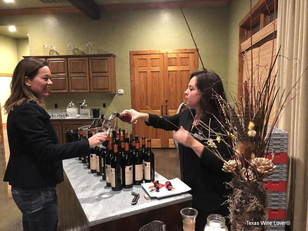 Pouring wine at Brennan's Library Heist