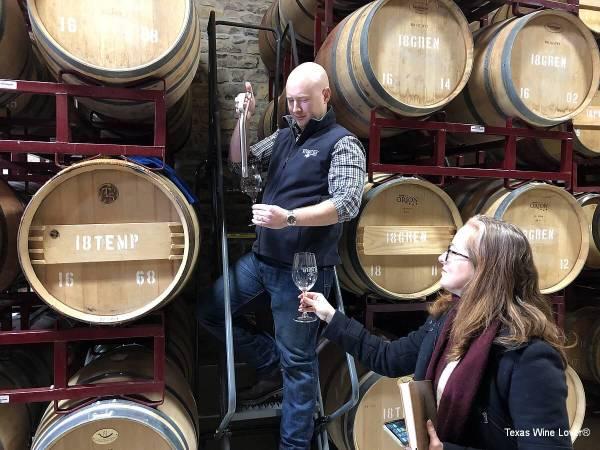 Seth Urbanek pouring from barrel