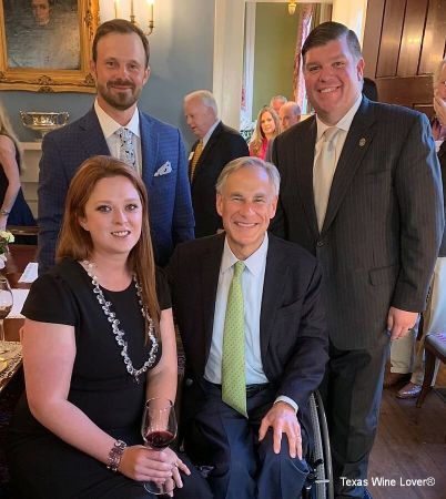 Rebecca Conley, Travis Conley, and John Hisaw with Governor Greg Abbott