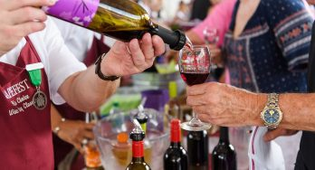 Pouring wine at GrapeFest