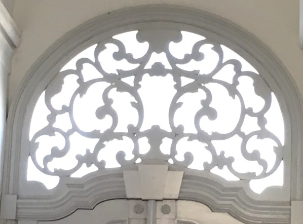 ornate scroll above palace door