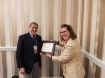 TYCA Executive Board Meeting in Washington, DC, November 2014. Outgoing Chair Andy Anderson receives appreciation certificate from Incoming Chair Eva Payne.