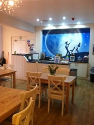 Ty Hapus Moon Dance Cafe area, with picture on wall of characters dancing in the moonlight.