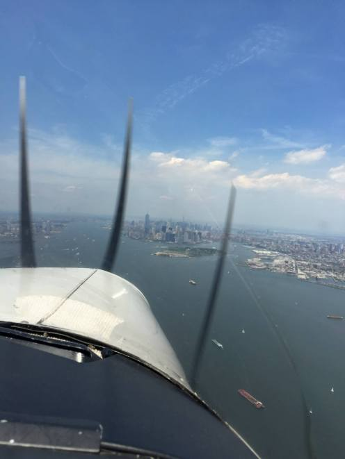 From the front seat of the plane, coming in hot over Manhattan