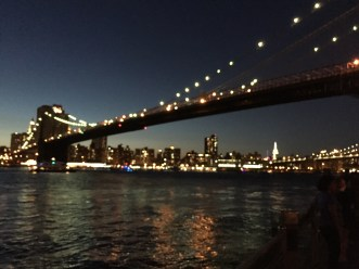 The Brooklyn Bridge lit up just after sunset